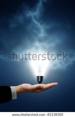 Light bulb hanging on business men. The background is a blue lightning bolt