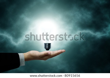Light bulb hanging on business men. The background is a green lightning bolt