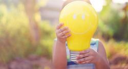 Light bulb idea sign.Smart kid in nature class.CSR Save the earth idea.light bulb imagination creative. Happy face good idea concept.Online learning.Education bright idea, energy save, Innovation, Ai.