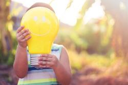 Light bulb idea sign.Smart kid.Solar power.CSR Save the earth idea.light bulb imagination creative.good idea concept.Online learning.Education bright idea, energy save, Innovation, Ai.Solar panel kid.