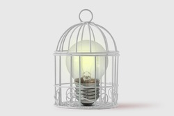 Light bulb in bird cage on white background - Concept of mind and freedom