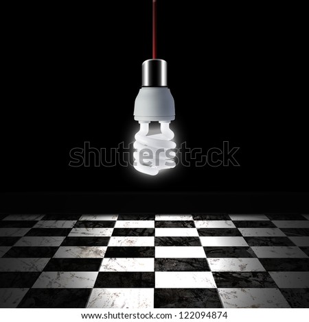 Light bulb in empty room with black and white checker floor