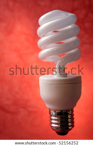 Light bulb in front of red background