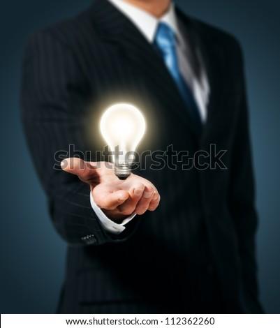 Light bulb in hand businessman