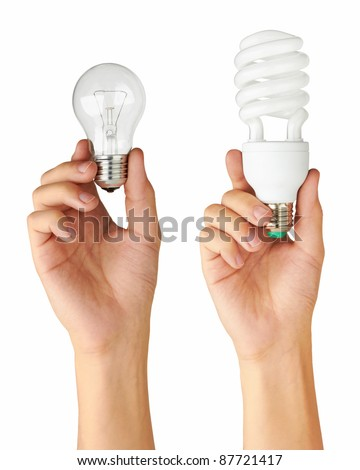 Light bulb in hand, isolated on a white background - stock photo