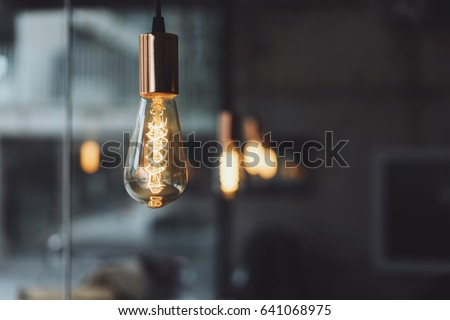 Light bulb in the coffee shop. Get and idea concept with copy space.