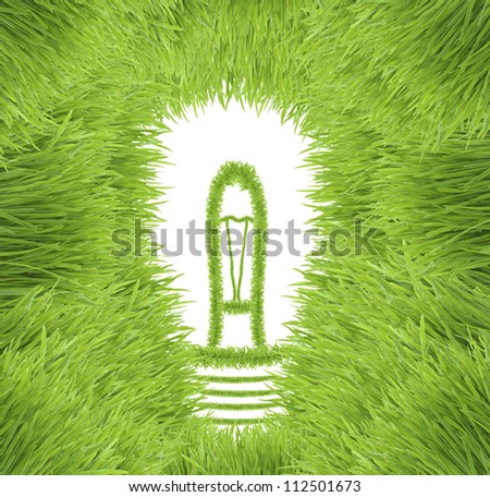 Light bulb made of green grass isolated on white background (ecological concepts)