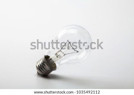 Light bulb on a white bckground #1035492112