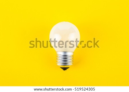 light bulb on a yellow background - Shutterstock ID 519524305