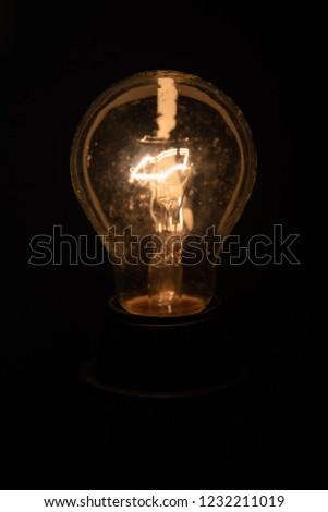 Light bulb on black background #1232211019