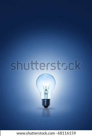 light bulb on blue background vertical.