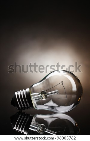 Light bulb on brown background