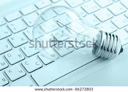 Light bulb on keyboard isolated