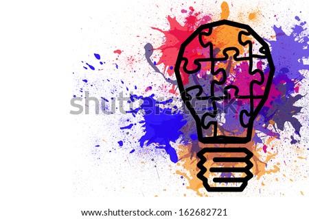 Light bulb on paint splashes