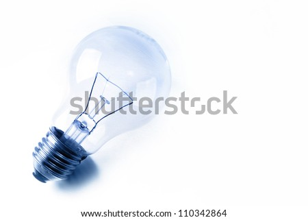 Light bulb on plain background
