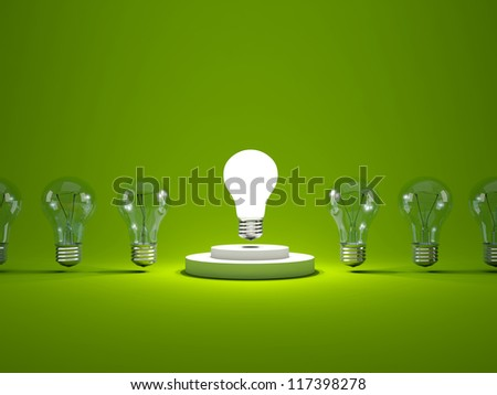 Light bulb on podium. In a row with other bulbs