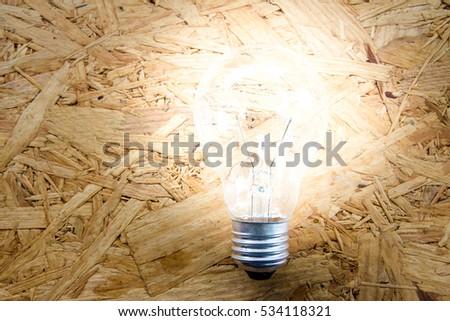 Light bulb on wood background, Inspiration,Ecology