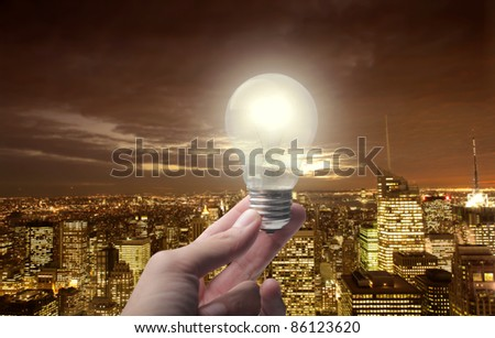 Light bulb over a night view of a big city