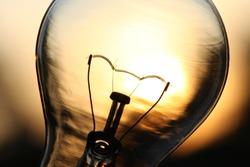 Light bulb over sunlight