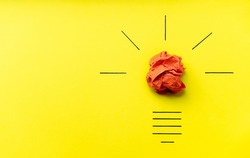 Light bulb over yellow background in vision and idea conceptual image. Conceptual image of creativity. Symbol of business strategy. Conceptual image of brainstorming, innovation and creativity