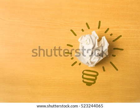 light bulb shape with paper ball on wood background, thinking differently concept, do not underestimate simple ideas concept