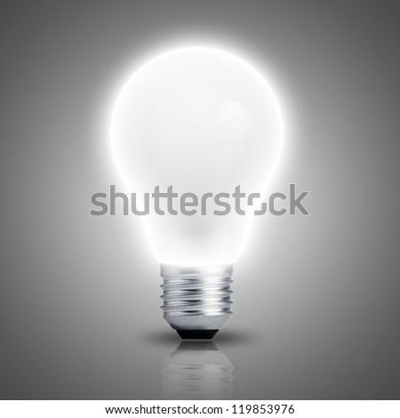 Light bulb turn on with grey background - stock photo