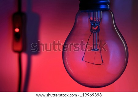 Light bulb turned off on a night scene background