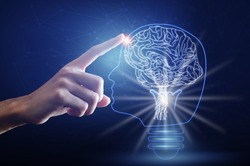Light bulb with brain, finger of person touching on head brain and point connecting network on blue background. Creative The brain in the light bulb, The concept of the business idea.