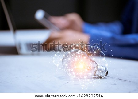 light bulb,with brain icon,creativity and innovative are keys to success,new ideas and innovation concept.