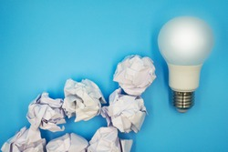 Light bulb with many crumpled paper on light blue background , brainstorm for great idea ,innovate and revolution of thinking process concept for business solution