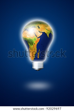 light bulb with planet earth over dark background