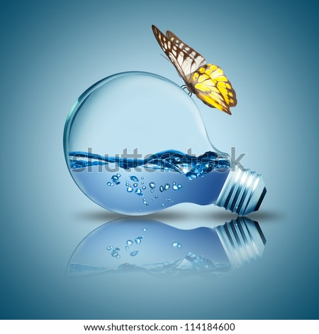 Light bulb with water inside and butterfly on the bulb. Concept for new idea of environment conservation - stock photo