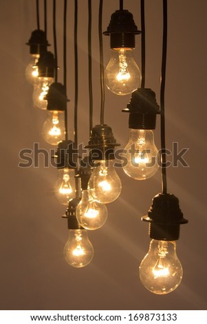 light bulbs hanging from the ceiling warm light