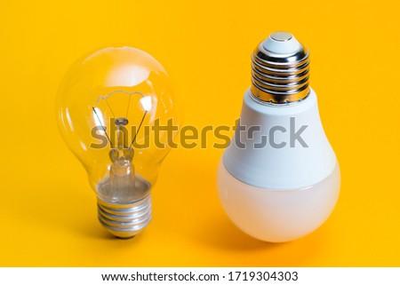 Light bulbs. isolated of Incandescent bulbs, fluorescent bulbs, orange old generation bulb, Tungsten bulb, and white energy saving bulb