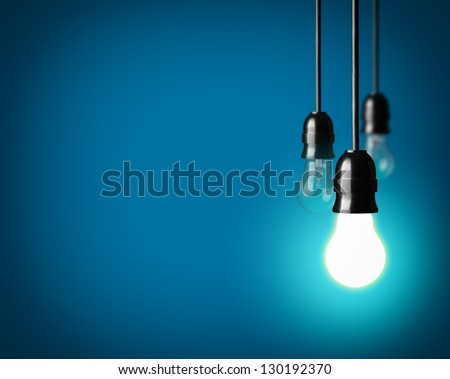 Light bulbs on blue background #130192370