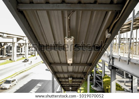 light bulbs on the metal roof of the stairs to the crossover Zdjęcia stock ©