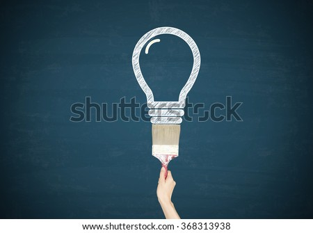 Light bulbs with hand paint on blue chalk board , business concept , business idea
