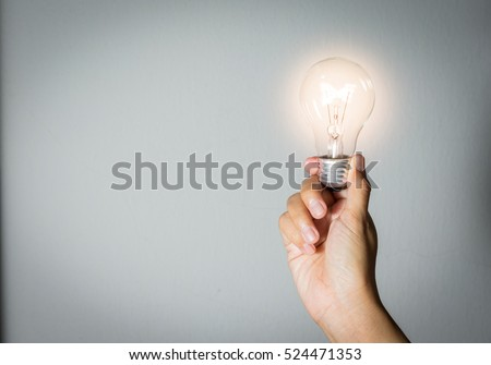 Light bulk in woman hand,concept idea.