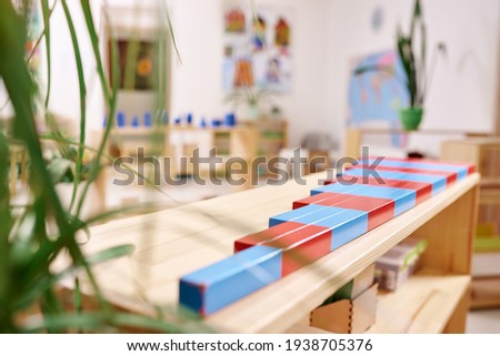 Light class in Montessori kindergarten. The colorful numeric rods in the foreground. nobody. ストックフォト ©
