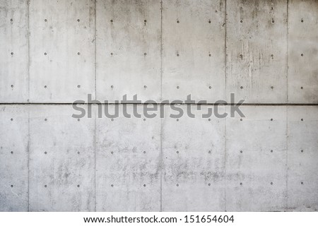 Light colored, raw or bare concrete wall, shot with panel seam lines perpendicular to image dimension.