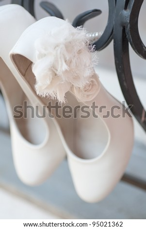 Light Colored wedding shoes on a white gown