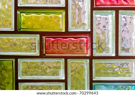 Light distorting colorful glass block window mosaic background pattern texture.