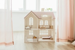Light Doll house interior miniature. View on children room in pastel neutral colors