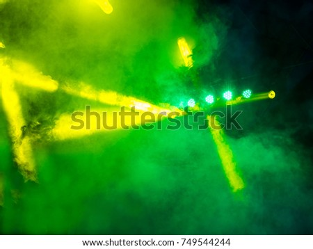 light during a concert, stage light with colored spotlights, green, yellow, white #749544244