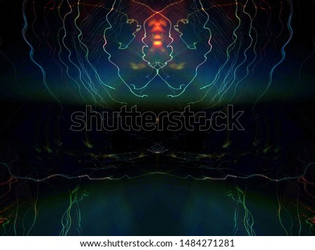 Light effects. Neon glow. Symmetry and reflection. Festive decoration. Abstract blurred background. Glowing texture. Shining pattern.