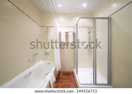 Light, empty and clean bathroom with white bath and shower cabin. #144556715
