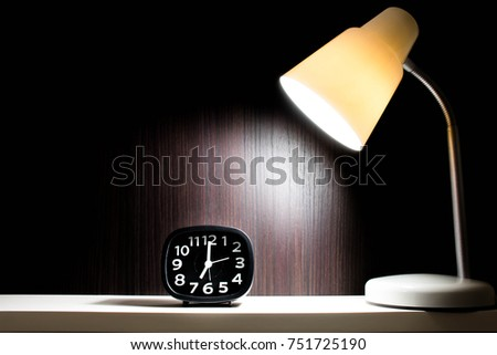 light from lamp focus clock at...