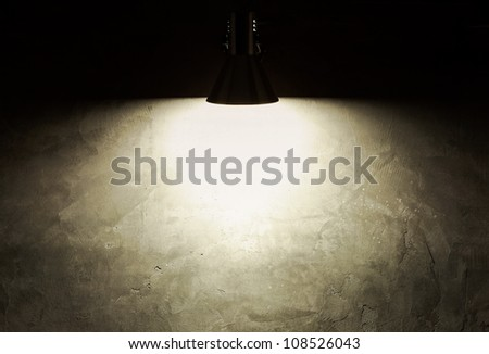 Light from lamp on concrete wall