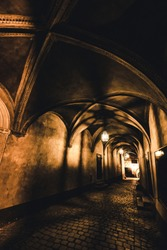 light from the lamp and the shadows in the mysterious corridor in the old dungeon in the castle