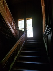 Light from the window at the top of the stairs